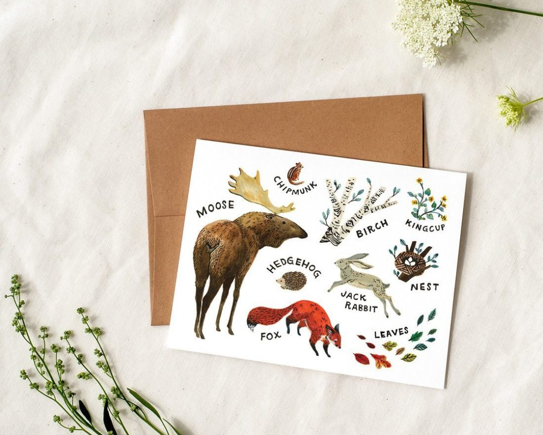 woodland baby card styled with greenery