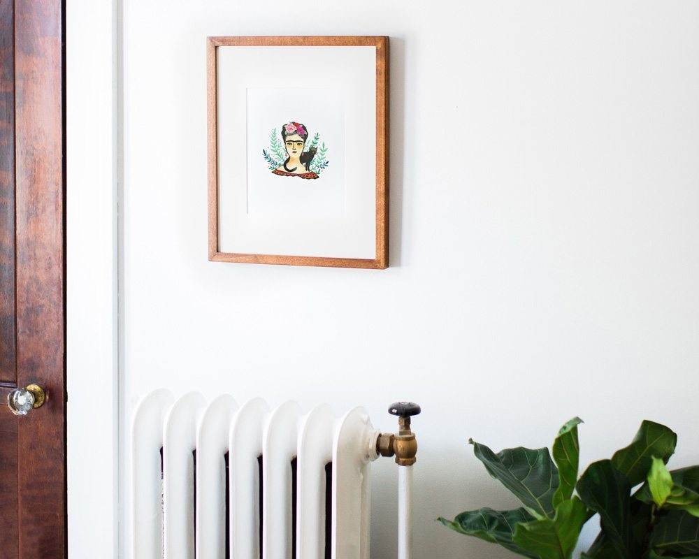 framed 8x10 frida kahlo art print illustration hanging on white wall