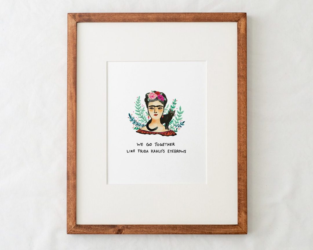 8x10 frida kahlo art print illustration with text that says we go together like frida kahlo's eyebrows in a natural wood frame