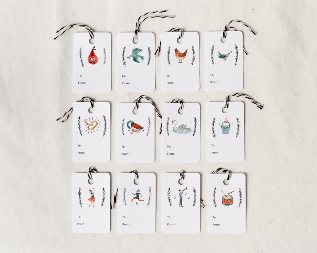 A set of 12 holiday gift tags featuring the 12 days of Christmas