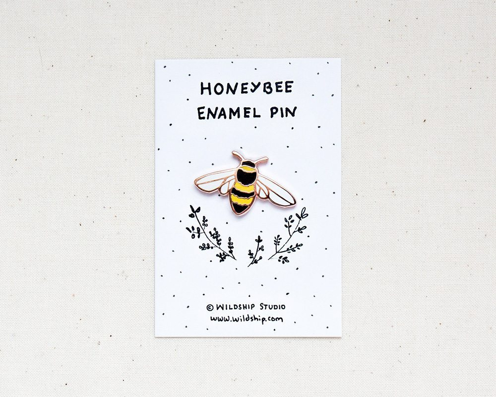 Honeybee enamel bee pin in packaging by Wildship Studio