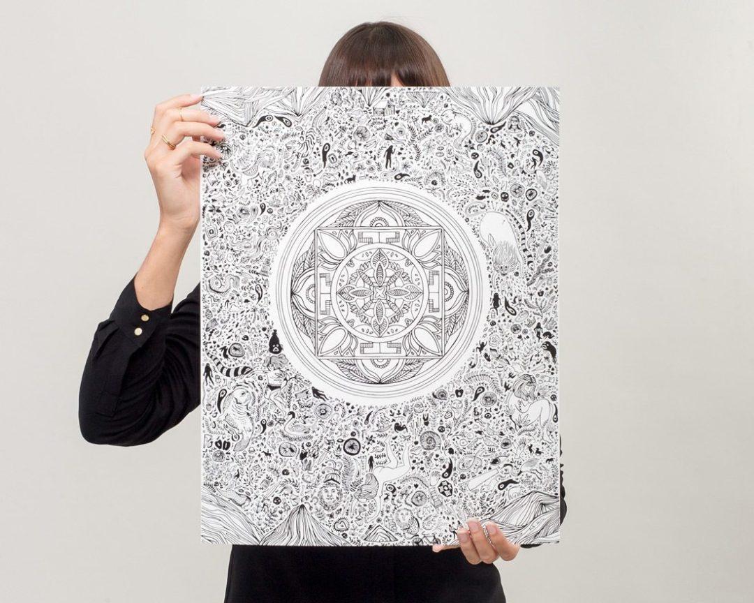 Woman displaying black and white illustrated nirvana lotus art print