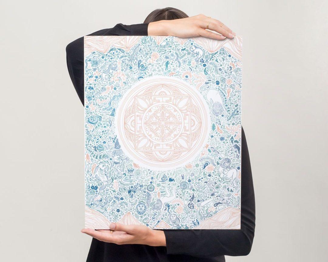 Woman displaying blue and pink illustrated nirvana lotus art print