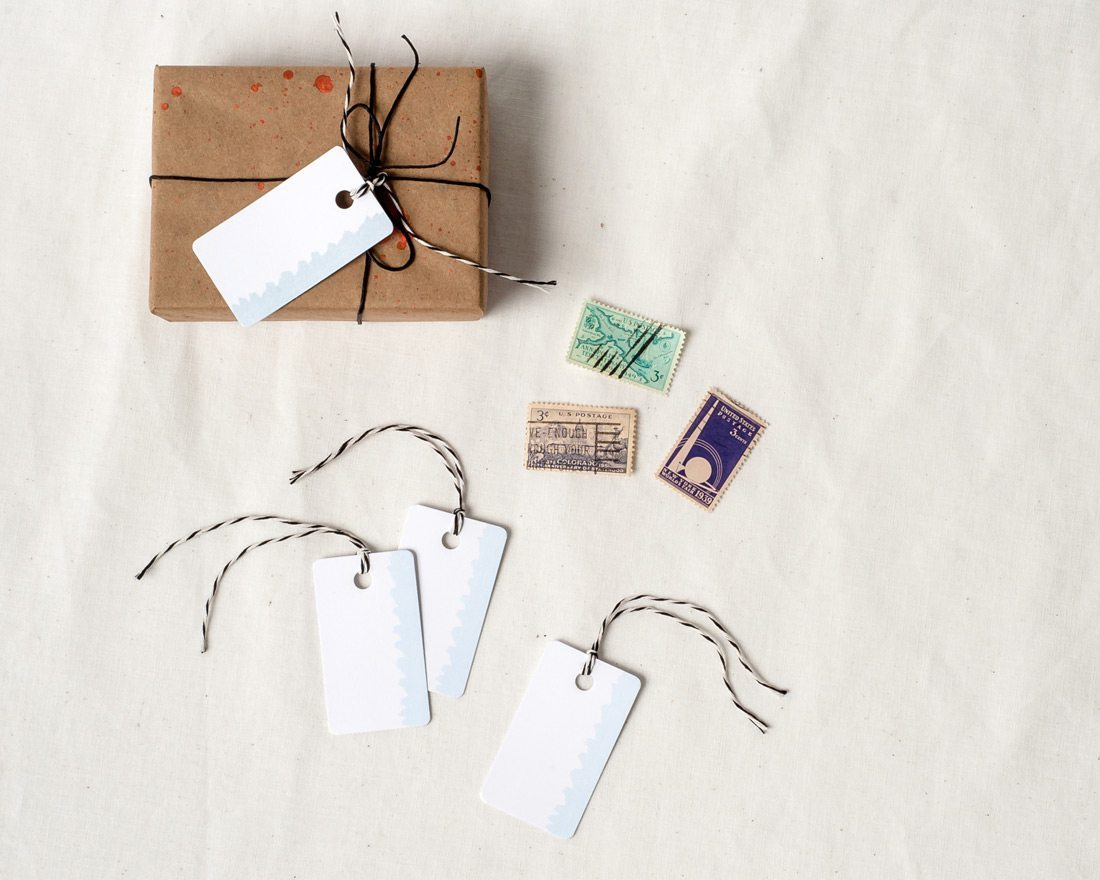 Set of watercolor gift tags arranged on wrapped packages