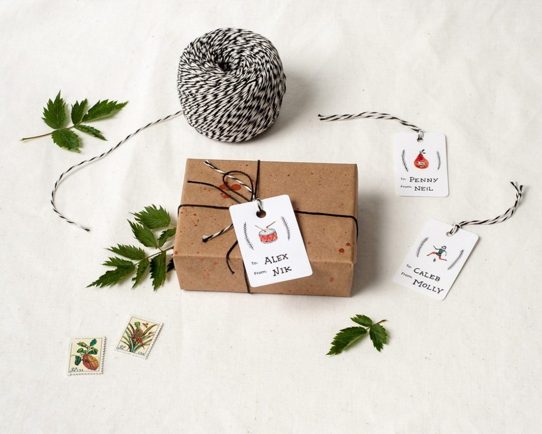 A set of 12 holiday gift tags featuring the 12 days of Christmas on a wrapped present