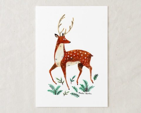 a 5x7 watercolor art painting of dainty spotted red deer with antlers looking over its shoulder with green foliage at its feet