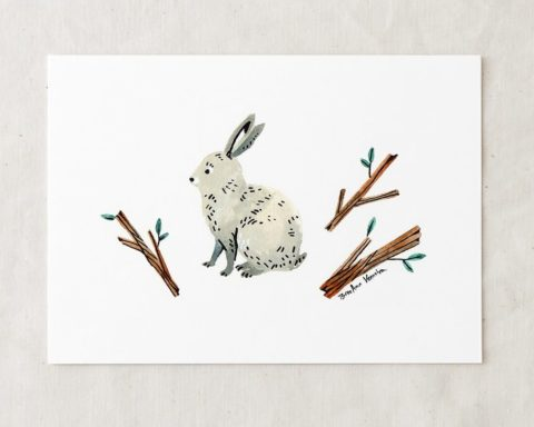 a 5x7 nursery watercolor art painting print of a white and gray bunny rabbit sitting and three leafy twigs