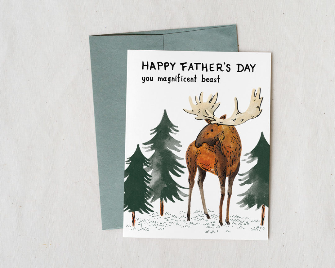 Illustrated card with a moose and pine trees that says Happy Father's Day you magnificent beast