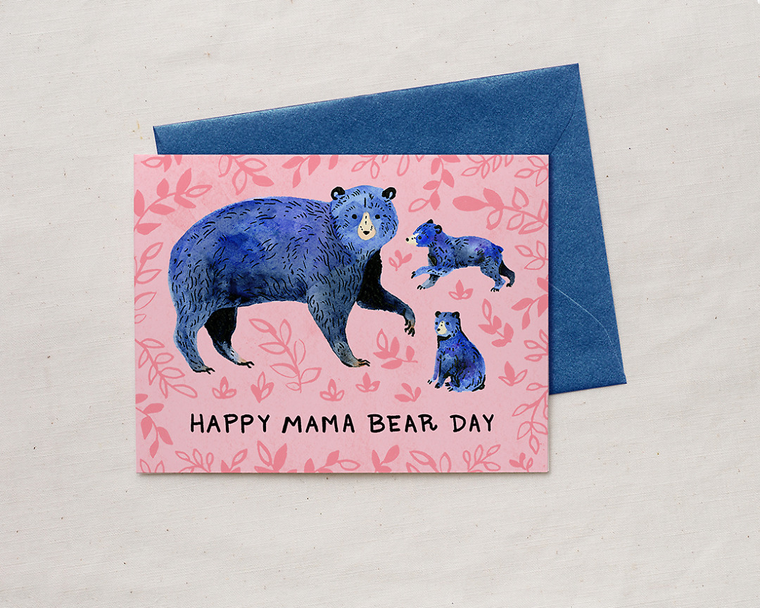 Mother's Day card with illustration of blue mom bear and two bear cubs with the words happy mama bear day and lavender envelope
