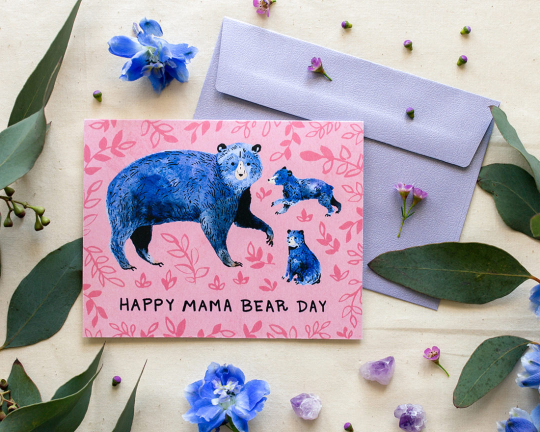 Mothers Day card with blue bears and the words Happy Mama Bear Day styled with florals and lavender envelope