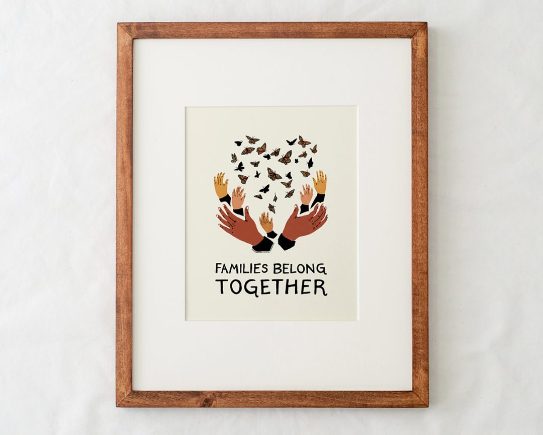 close-up detail of families belong together artwork