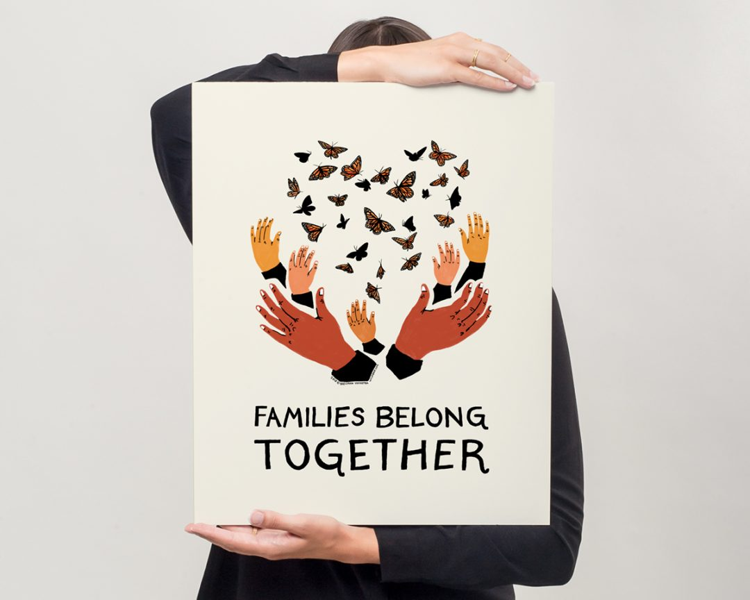 model holding protest sign of families belong together artwork