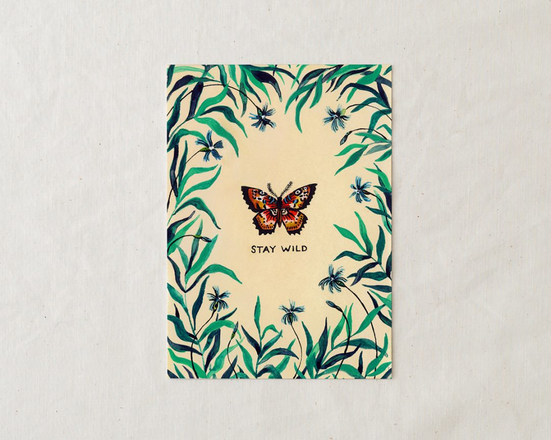 wildship studio art print of garden butterfly with green foliage and blue flowers and the words stay wild