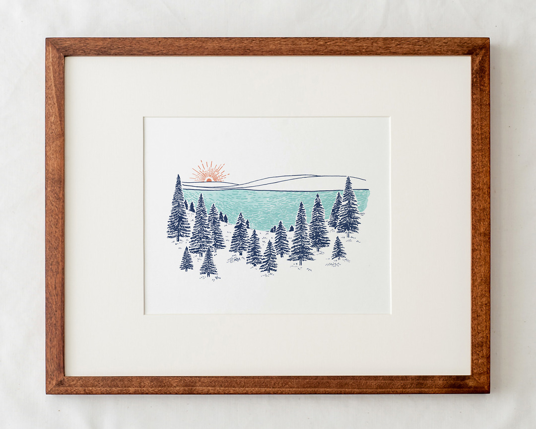 lakeshore art print with pine trees illustration in natural wood frame