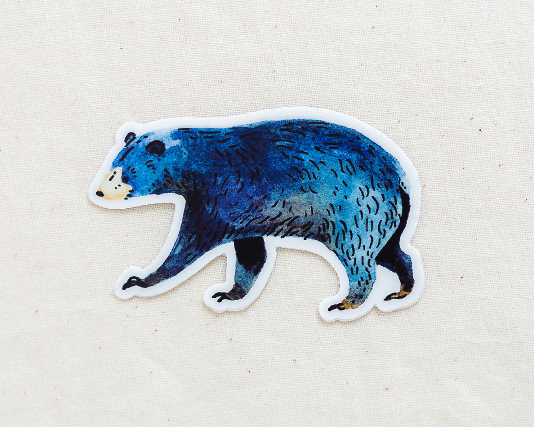 a cute black bear vinyl sticker by wildship studio