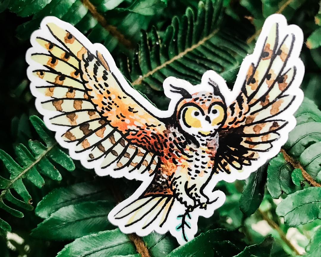 cute owl vinyl animal sticker art by wildship studio against plant background