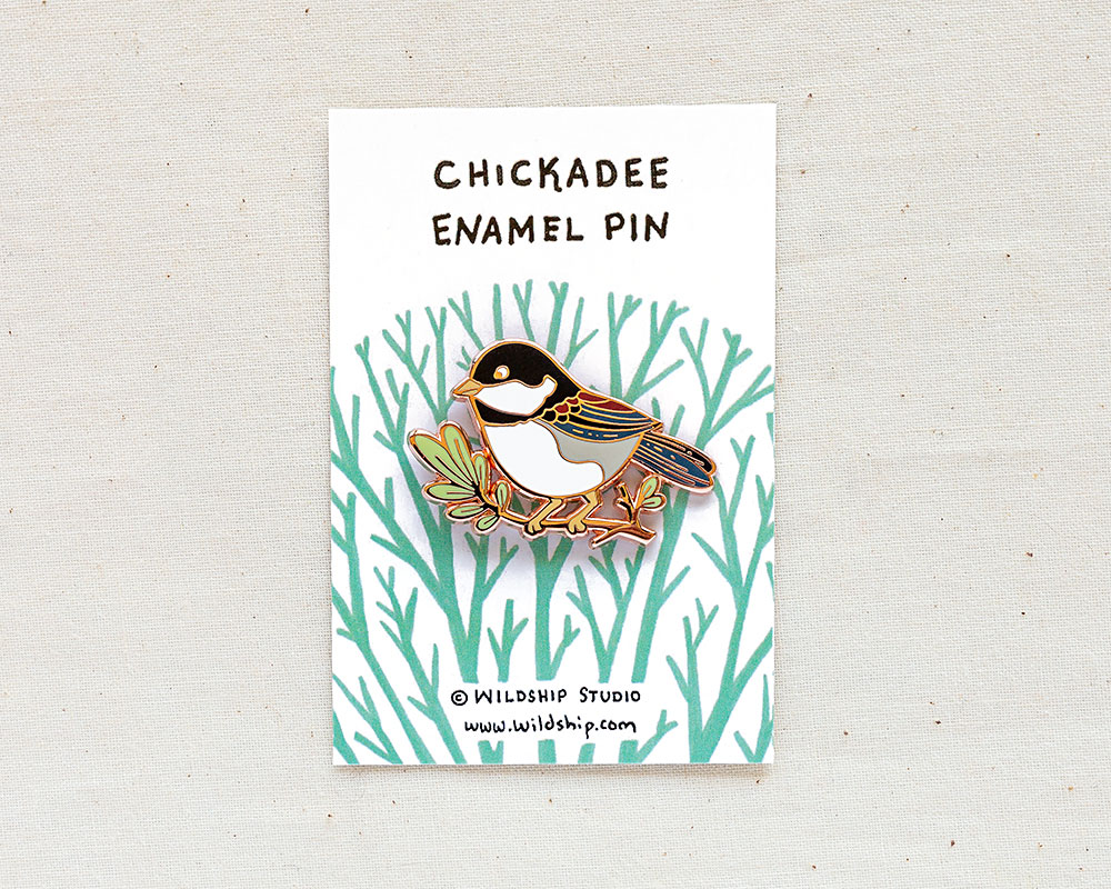 chickadee enamel pin in packaging by wildship studio