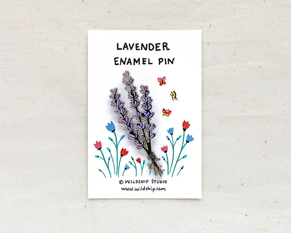lavender enamel pin in packaging by wildship studio