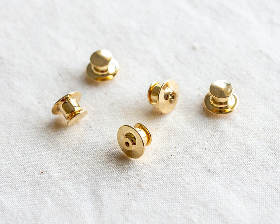 set of five deluxe gold locking pin backs