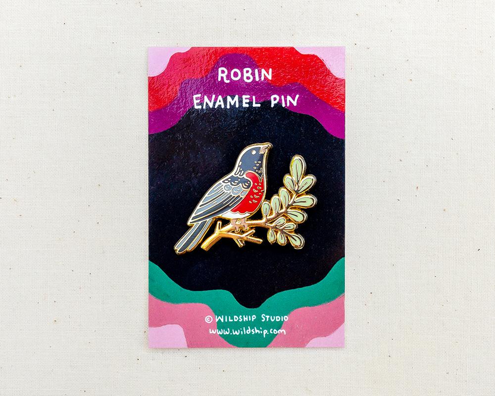 robin enamel pin in packaging by wildship studio