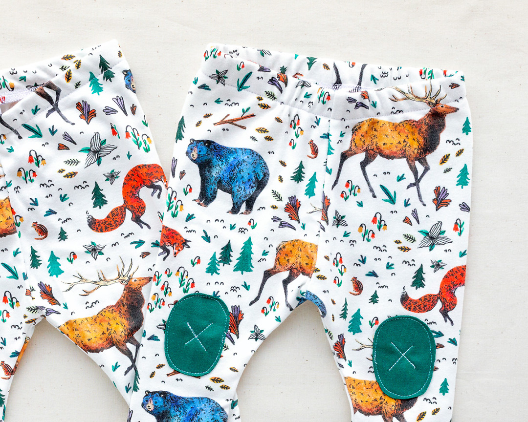 close up detail of Organic Baby Leggings with bears elk foxes by Wildship Studio