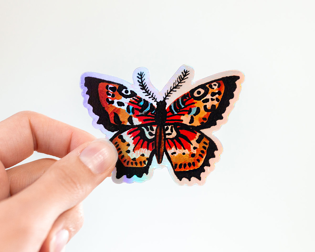 hand holding cute holographic butterfly vinyl animal sticker by wildship studio