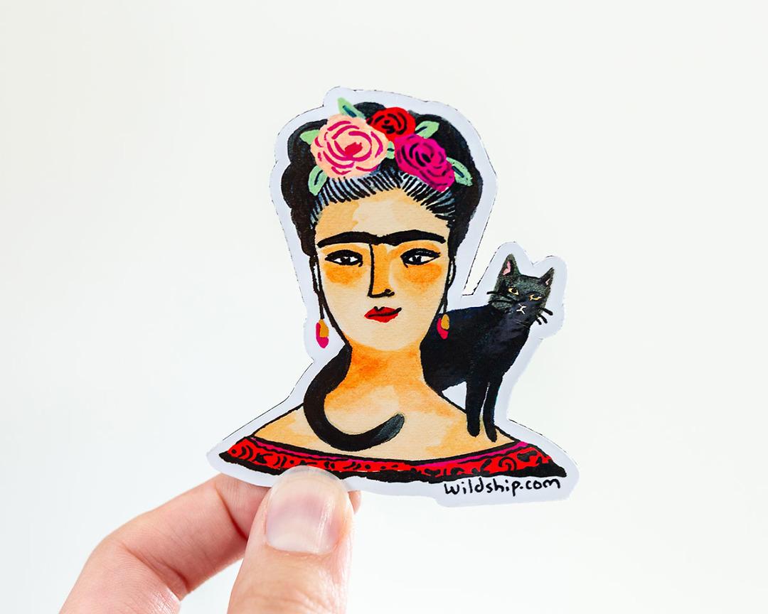 hand holding frida kahlo magnet by wildship studio