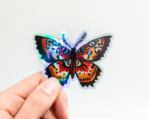 hand holding holographic butterfly vinyl animal sticker by wildship studio