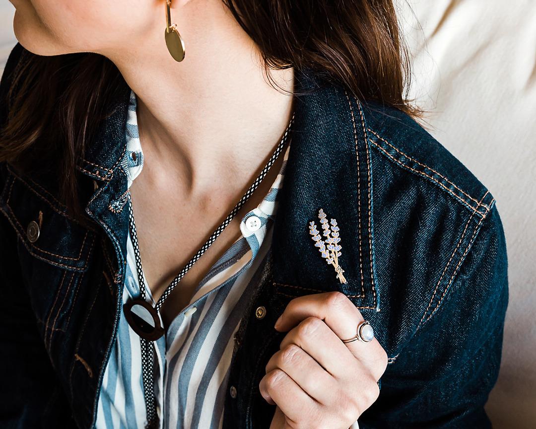 silver floral lavender enamel pin on denim jean jacket cuff