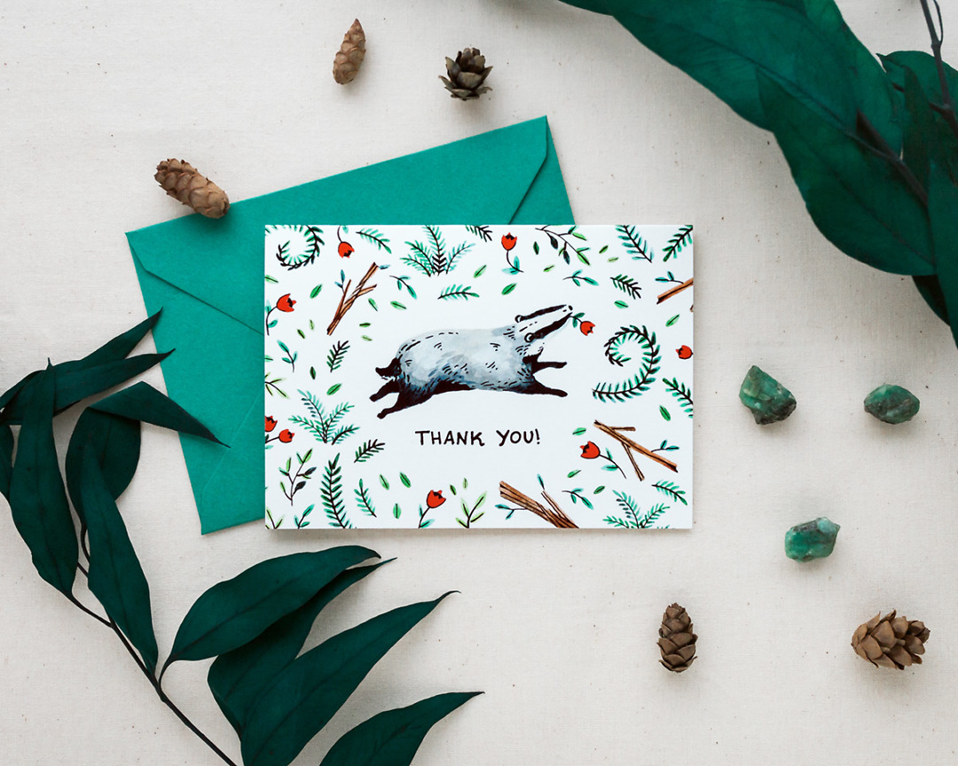 thank you card and envelope with a cute woodland badger styled with pinecones and greenery