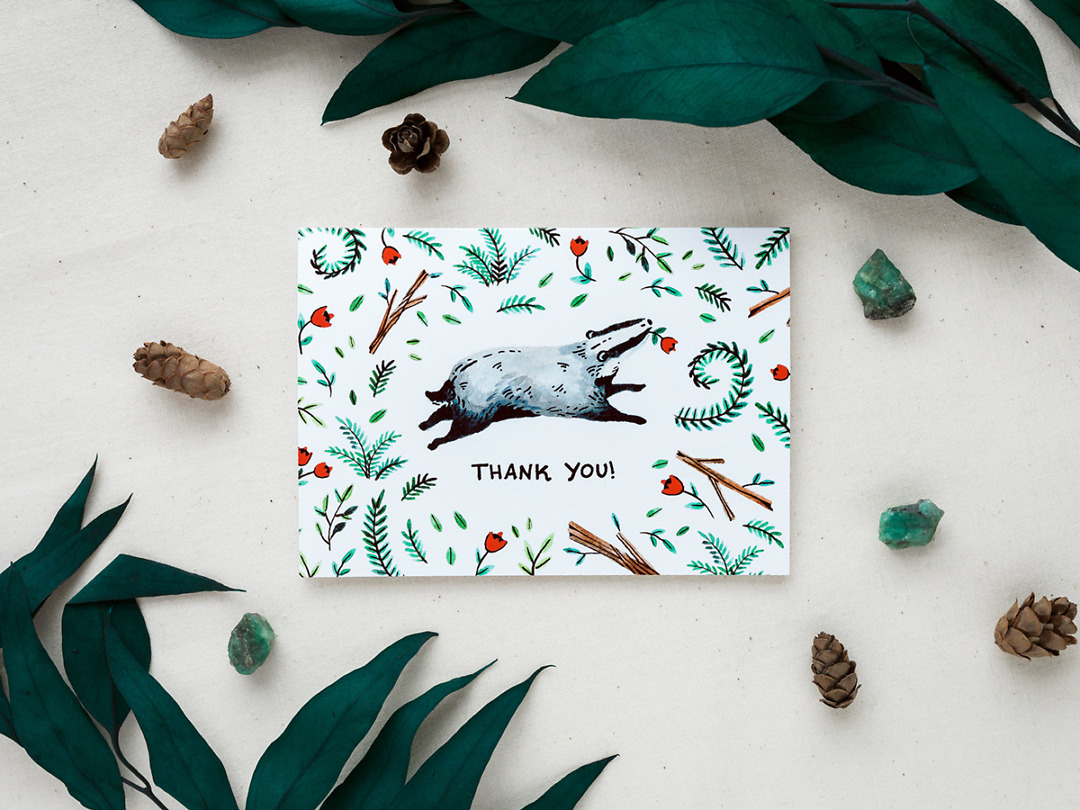 thank you card with a cute woodland badger styled with pinecones and greenery